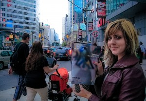 Actor Aimee Lynn Chadwick works TIFF at Dundas Square.  Photo by the author.