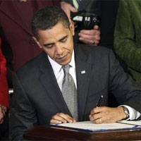 President Barack Obama signs a bill to delay the conversion from analogue to digital television broadcast